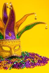 Colorful Mardi Gras or venetian mask on yellow