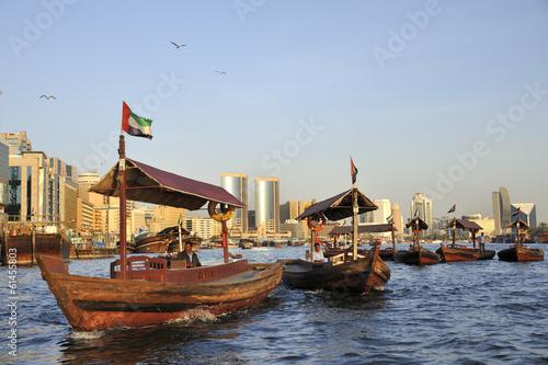 Fotobehang Dubai View of Deira quarter from Dubai creek with abra's or water taxi