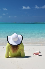 Girl in the hat on the beach of Exuma, Bahamas