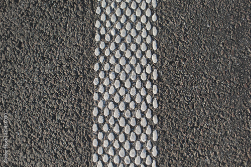 asphalt with vertical stripe