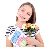 Beautiful little girl with flowers and postcard in her hand,