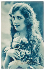 retro portrait of young woman with flowers