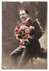 young man with rose flowers. vintage photo