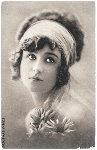 portrait of young beautiful woman with flowers © LiliGraphie