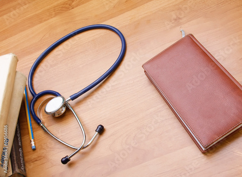 Stethoscope with reference books.