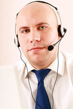 A call center employee with a headset, isolated on white