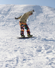 Snowboarder standing on board