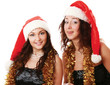 Happy girls in santa hat isolated on white background.