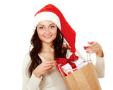 Smiling girl in santa hat with bag full of xmas gift