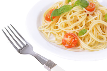 Delicious spaghetti with tomatoes on plate close-up