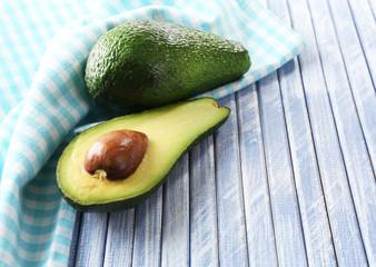 Fresh avocado on wooden table