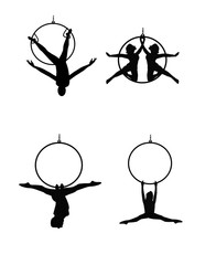 aerial ring dancers in silhouette