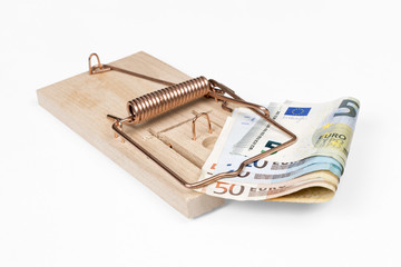 Mouse trap with Euro bills over white with clipping path.