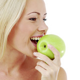 Woman bites an apple