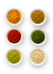 Various spices in a cup on a white background