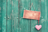Valentine heart and sign board on wooden background