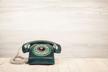 Retro rotary telephone on wood table
