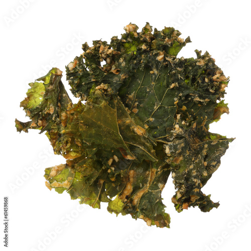 Roasted kale chips isolated on white background