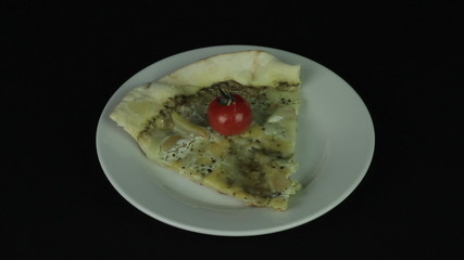 Slice of pizza in a white plate revolves loop