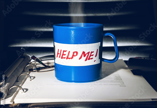 "Creative help concept. Coffe mug with a message ""Help me!"""
