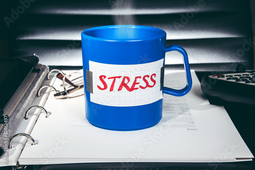 "Creative stress concept. A blue mug with a message ""Stress"""