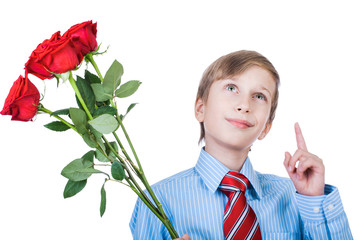 Cute romantic child holding roses and thinking