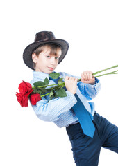 Beautiful stylish romantic boy holding a bouquet of red roses