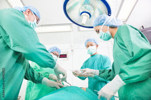 Team surgeon  working in operating room.