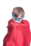 cute funny child superhero hiding in his cape