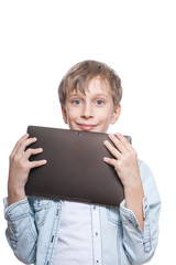 Cute blond boy in a blue shirt holds a tablet pc