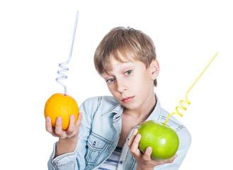 Beautiful stylish child holds an orange and grapefruit