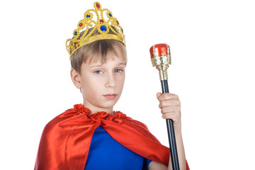 Beautiful funny child king with a crown holding scepter