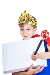 Beautiful cheerful child king with a crown holds white board