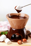 Chocolate fondue with marshmallow candies,