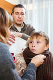 caring parents giving medicinal sirup to  son