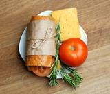 Fresh and tasty sandwich on wooden background