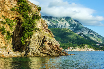 Summer beach, rocks and hill, Budva, Montenegro