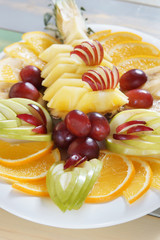 Diverse assorted fruits in a large dish