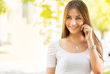 Portrait of beautiful young woman using a Cell Phone.