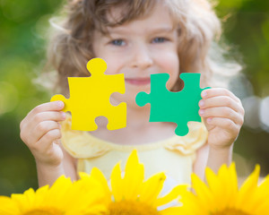 Child holding puzzles