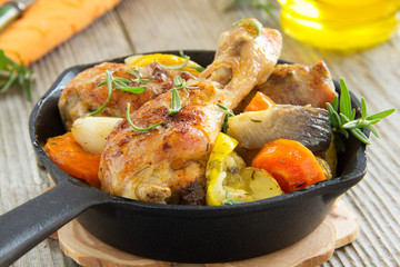 Fried chicken legs with vegetables.
