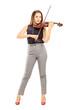 Full length portrait of a female violinist