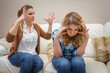 Furious mother arguing with her ​​teenage daughter
