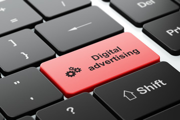 Advertising concept: Gears and Digital Advertising on computer