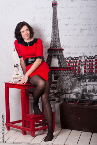 young smiling woman on a red chair