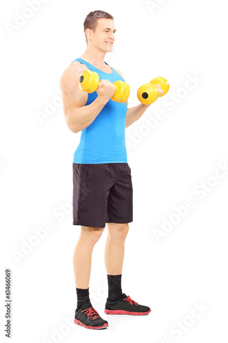 Male athlete working out with dumbbells