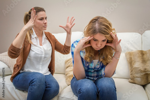 Fototapeta Furious mother arguing with her ​​teenage daughter