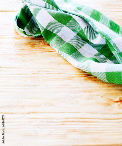 green and white towel on the table