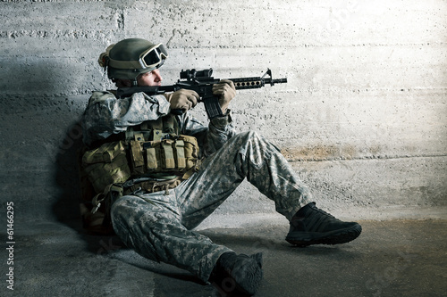 Soldier aiming a rifle