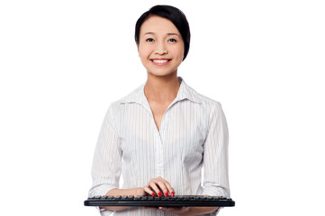 Smiling woman posing with keyboard